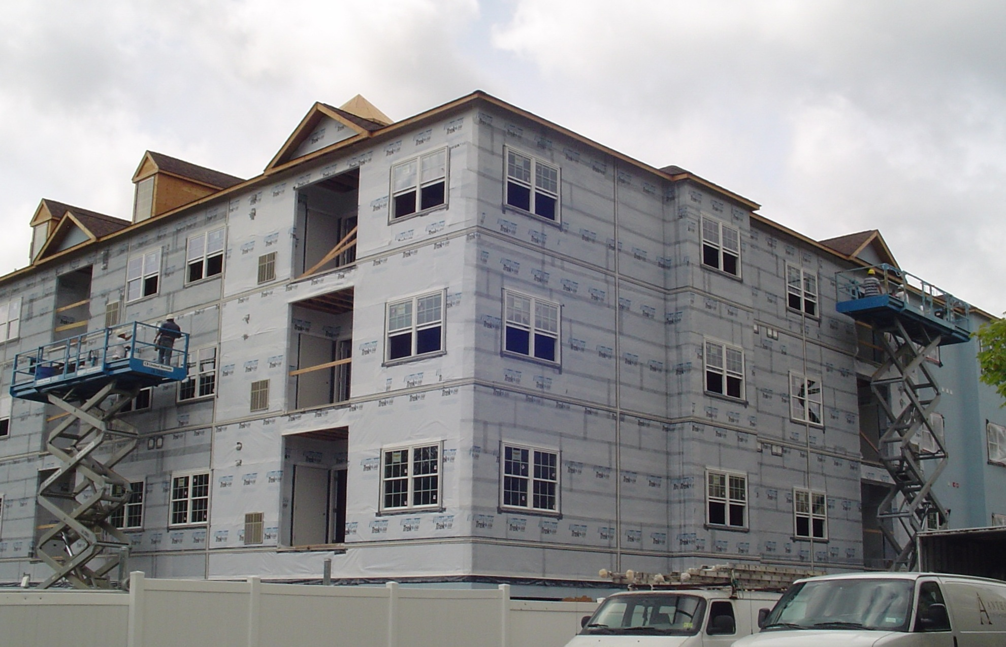 Apt building in Passaic County, stucco prep work done from scissor lift