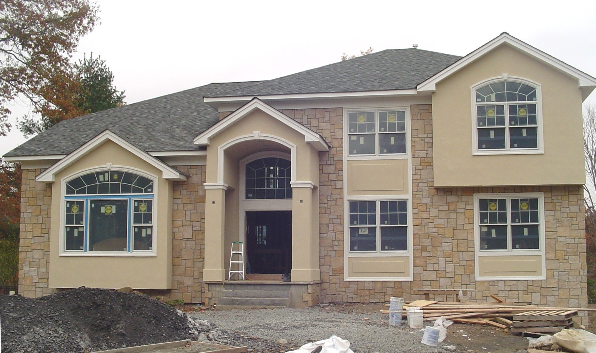 Stucco and stone front with custom trim detail