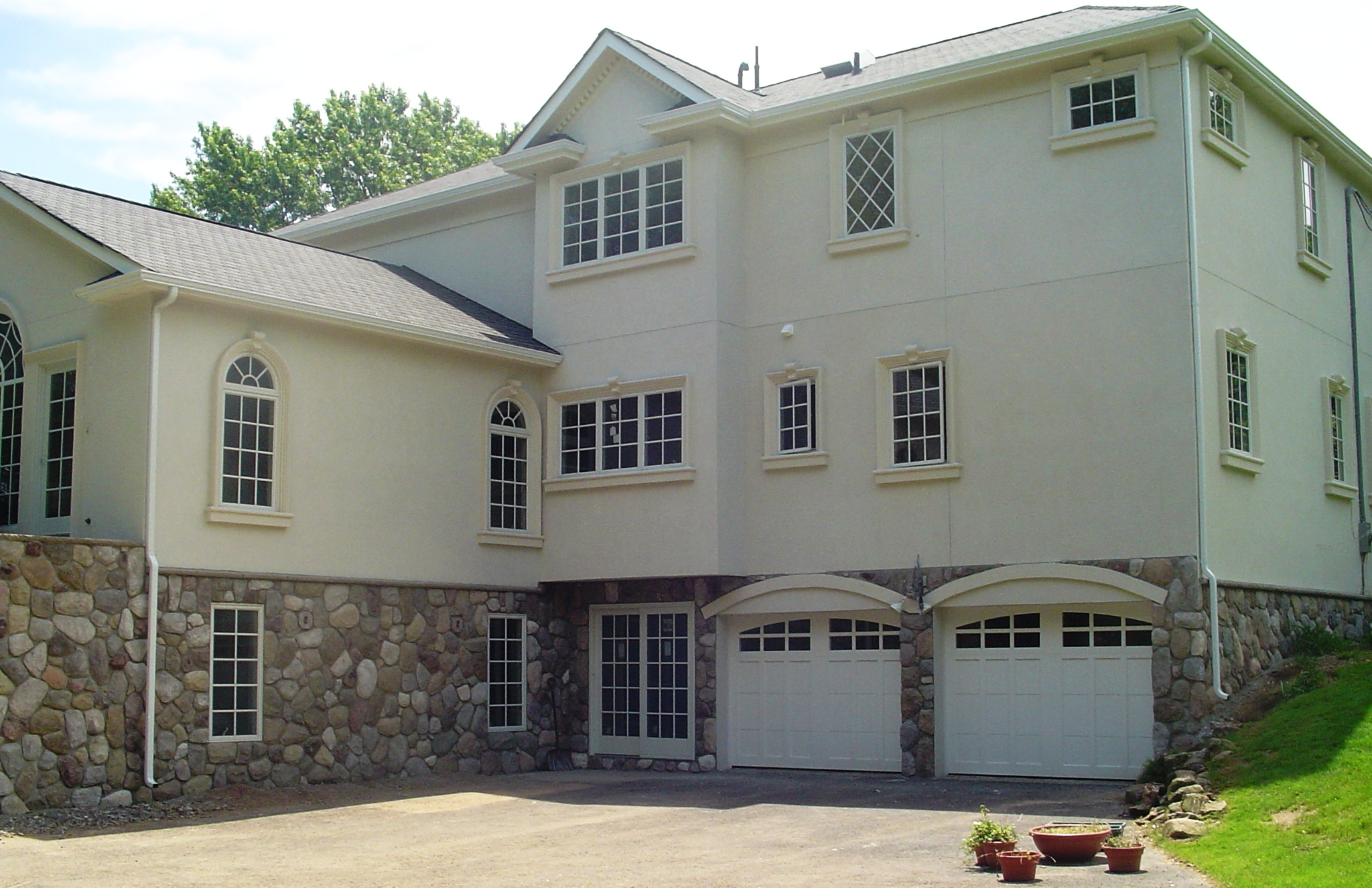 Custom home in Union County. Hardcoat stucco, stone, custom trim detail.