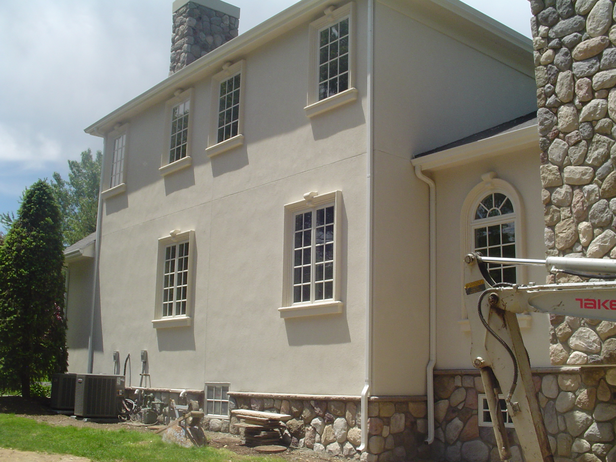 Hardcoat Stucco, Stone, Custom Trim Detail.