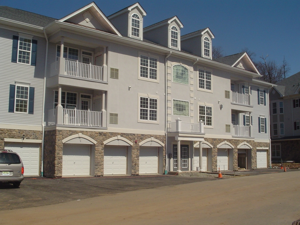 Townhouse development in Passaic County with hardcoat acrylic stucco, stone and custom trim detail.