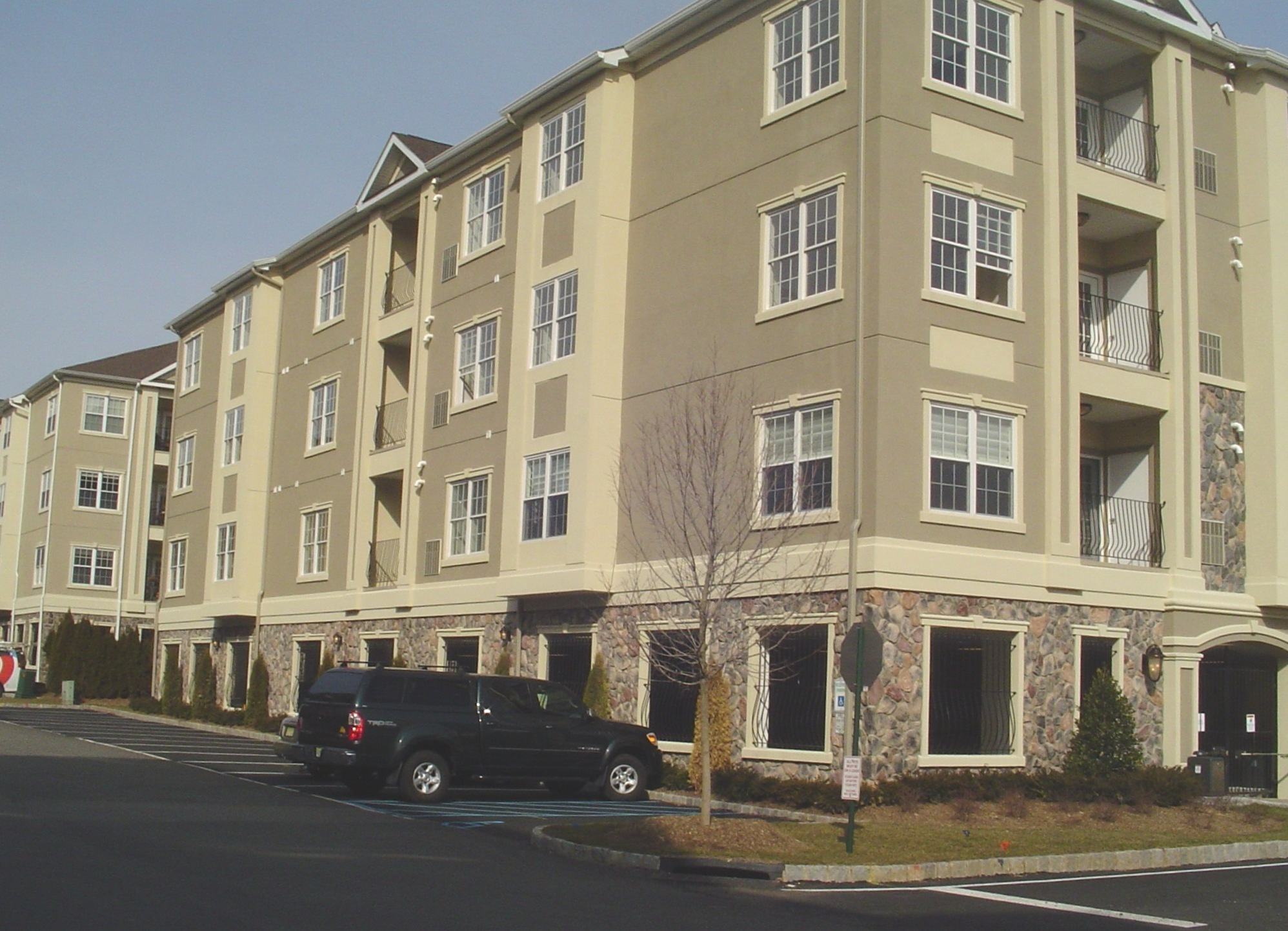 Apt building in Passaic County, stucco and stone work