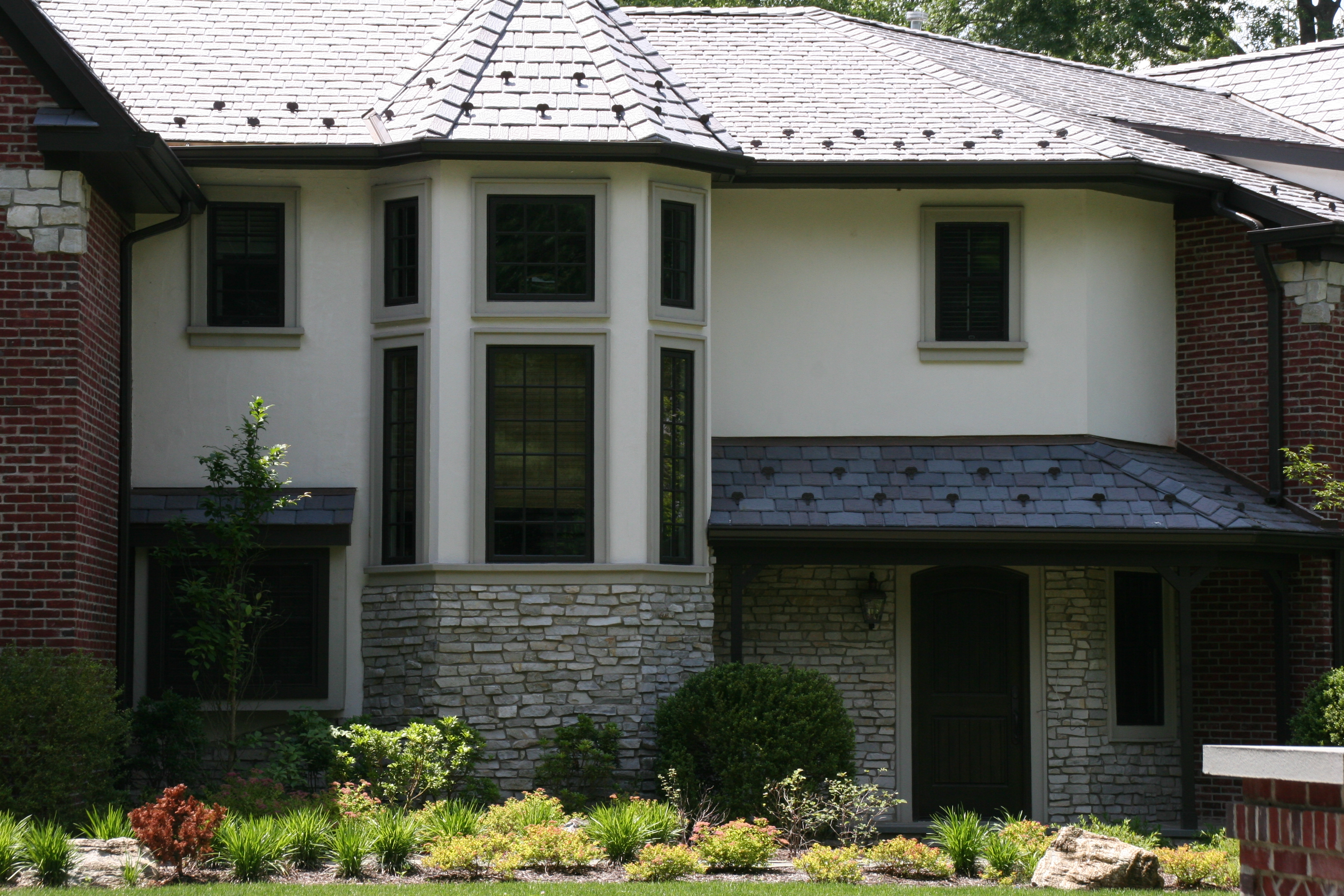 Hardcoat acrylic stucco with custom window trim.