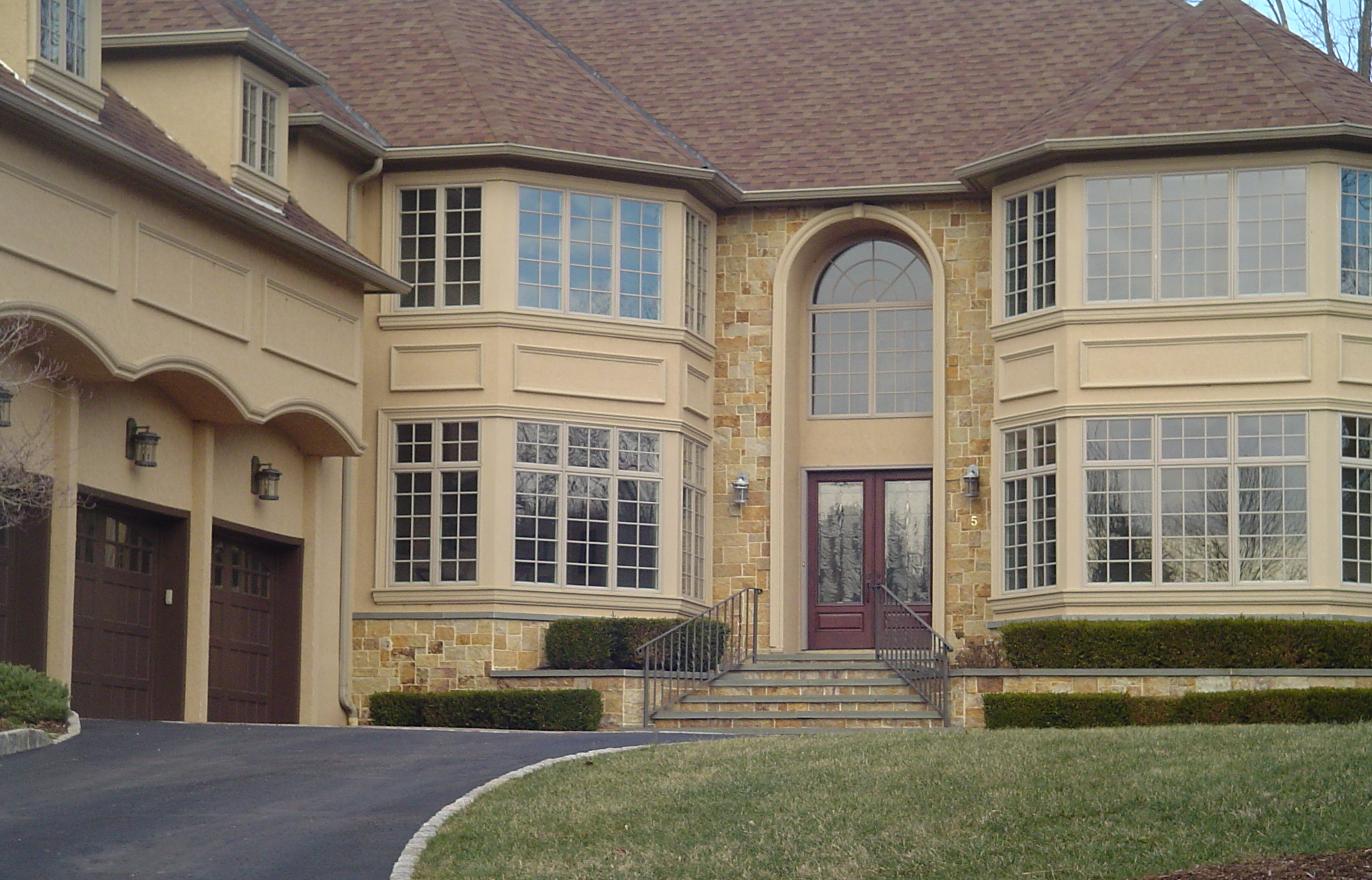Hard coat stucco with custom trim and stone in Somerset County