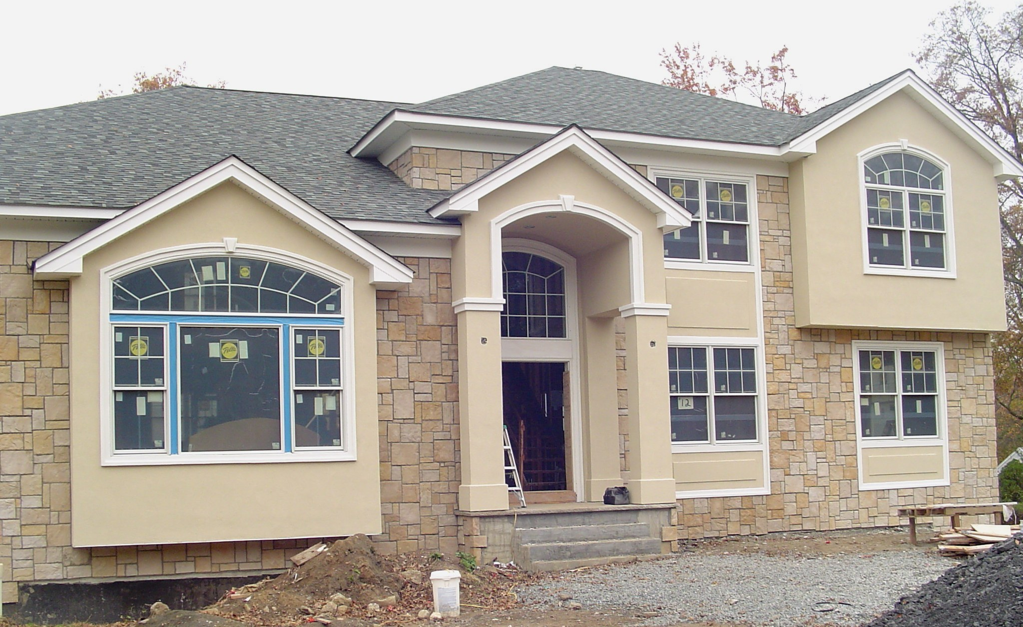 Arched window trim american brickface stucco - Houses with arched windows ...