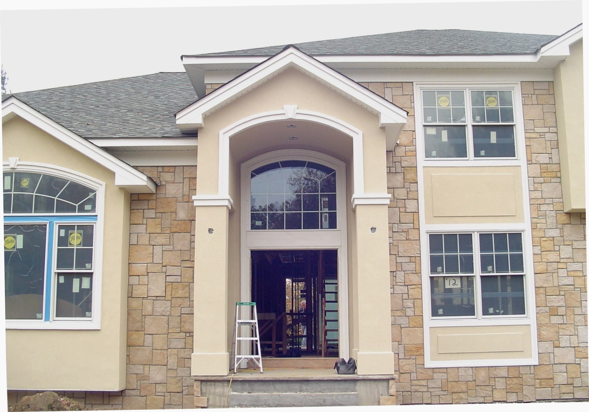 Stone american brickface stucco exteriors for Stucco columns