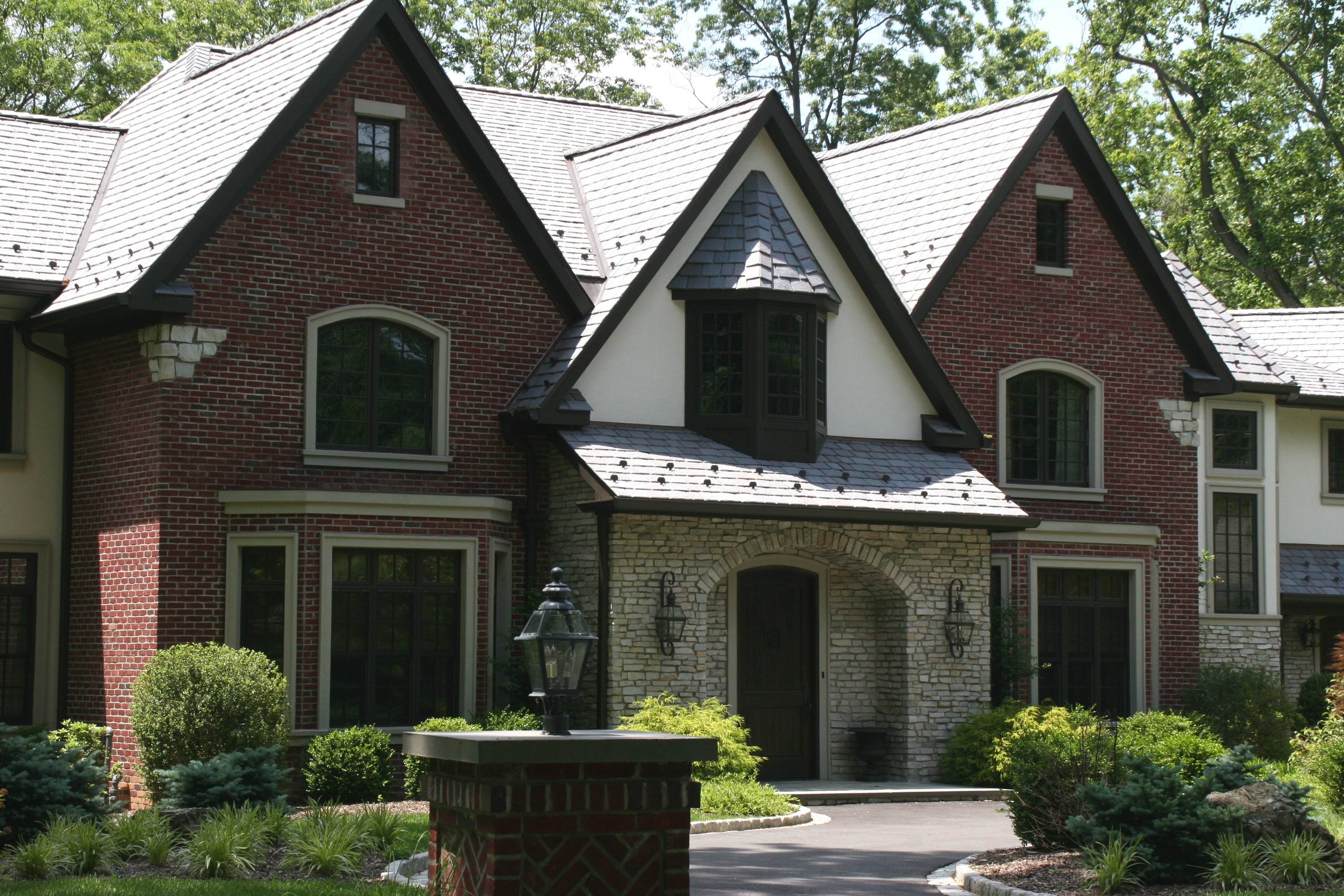 Stone american brickface stucco exteriors for Brick stone combinations