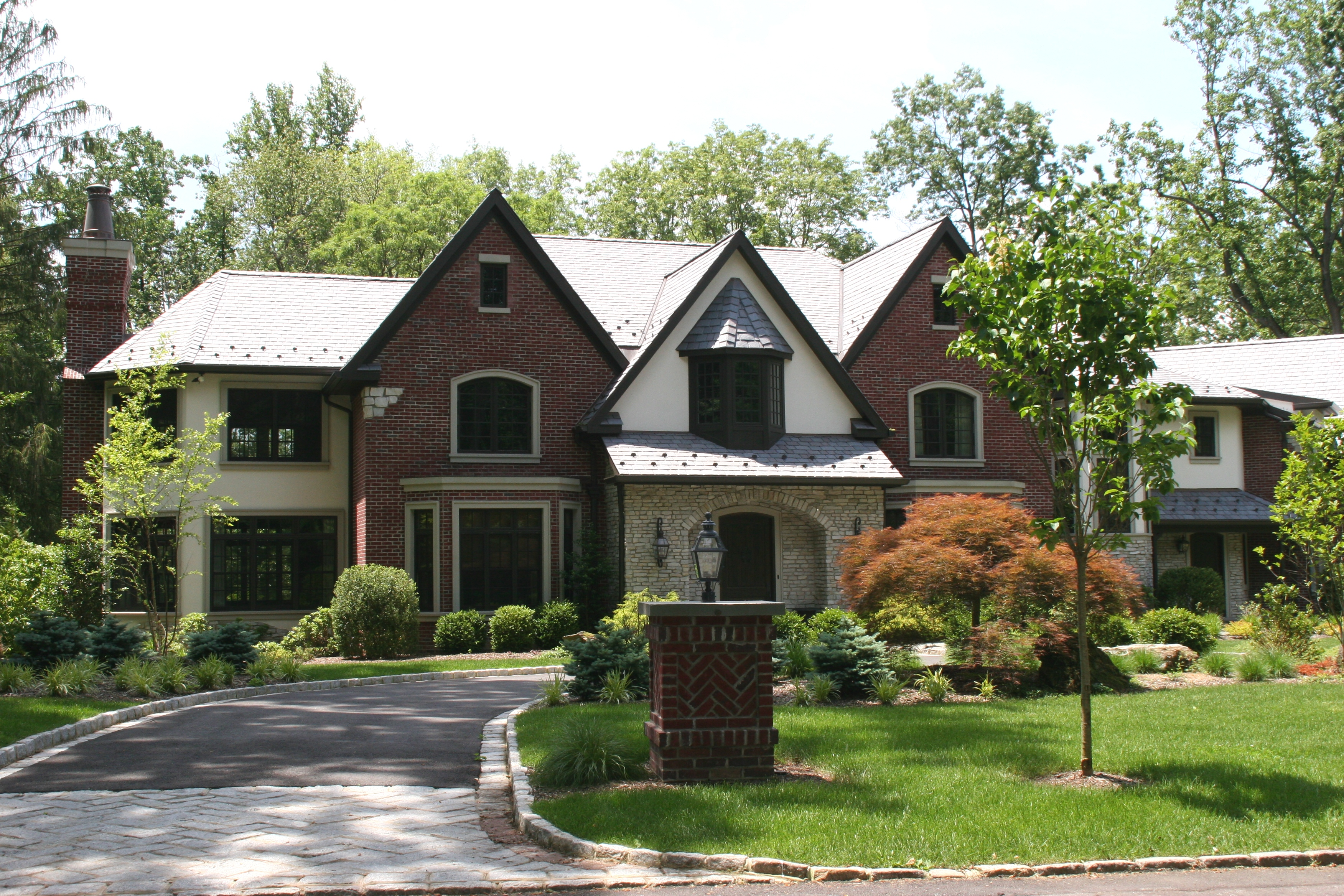 Stone american brickface stucco exteriors for Custom stone homes