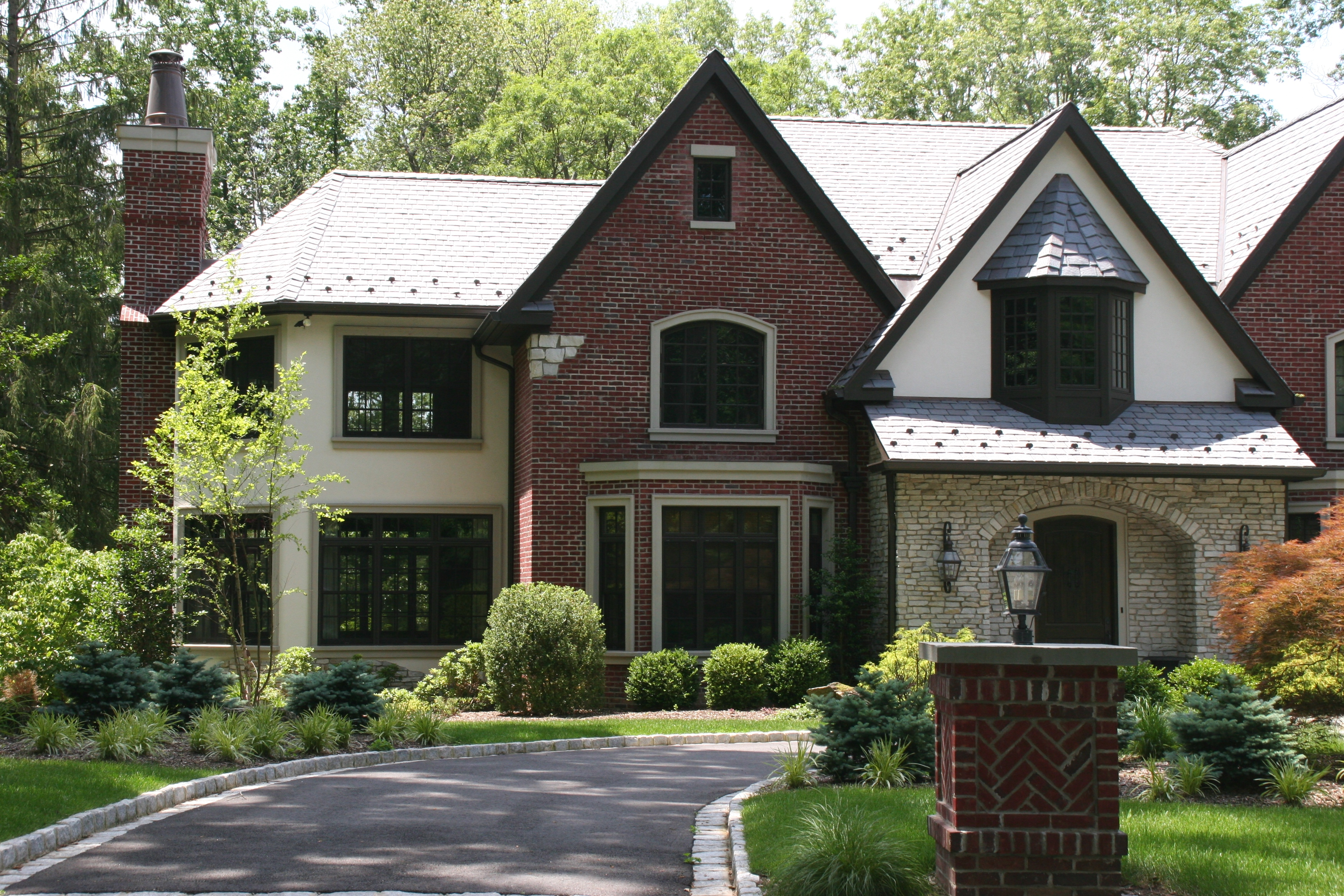 Stone american brickface stucco exteriors for Stone homes
