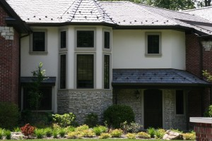 Hardcoat acrylic stucco with window trim at bump out.